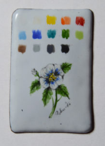 Palette and miniature on foundation white base one layer for the palette three thin layer for the flower three firings