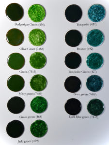 Figure 12: Dark green transparent enamels applied directly on copper base and directly on pure silver foil.