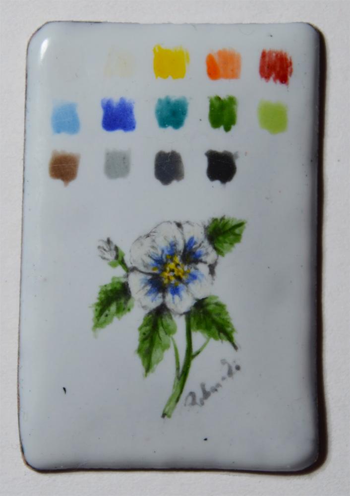 Figure 3: Palette dei colori e fiore in miniatura su base di Foundation White 7312 WGB. Uno strato di colore per la palette e tre strati sottili per la realizzazione del fiore. Cotta tre volte a 800◦ C